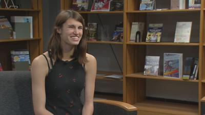 JCPS senior defies the odds with a smile, graduates with diploma and college degree