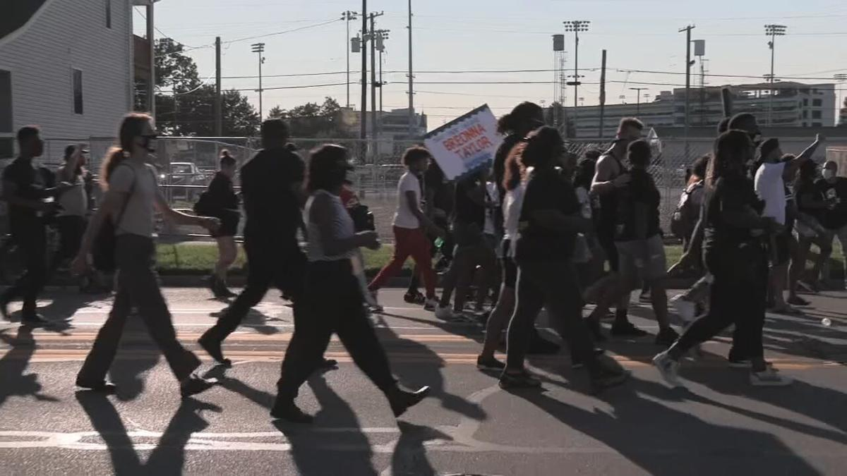 Protesters march past Churchill Downs on Derby day
