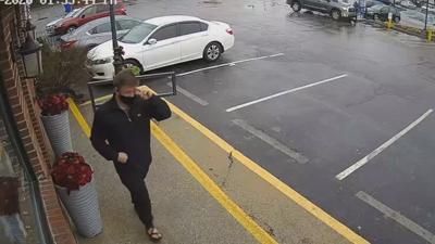 Man placing anti-Semitic ideas on doors.jpeg