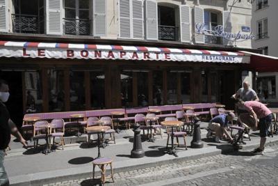 Waiters prepare terrace of restaurant in Paris