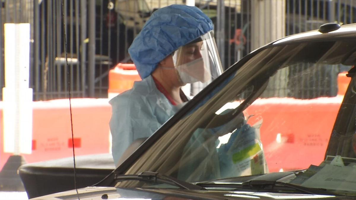 Health worker at UofL Health's downtown Louisville testing site