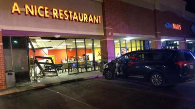 Car jumps the curb and crashes into southern Indiana restaurant