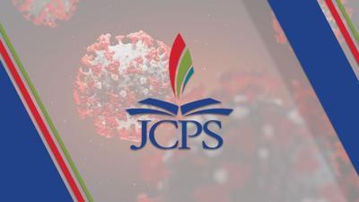 JCPS logo over coronavirus