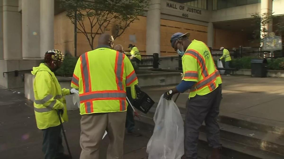LOUISVILLE WORKERS CLEAN UP AFTER PROTEST AND FIRES DOWNTOWN - 9-24-2020  (1).jpeg