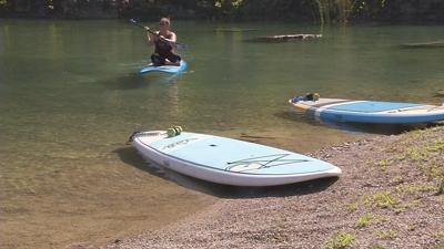 Louisville company offers paddle board yoga