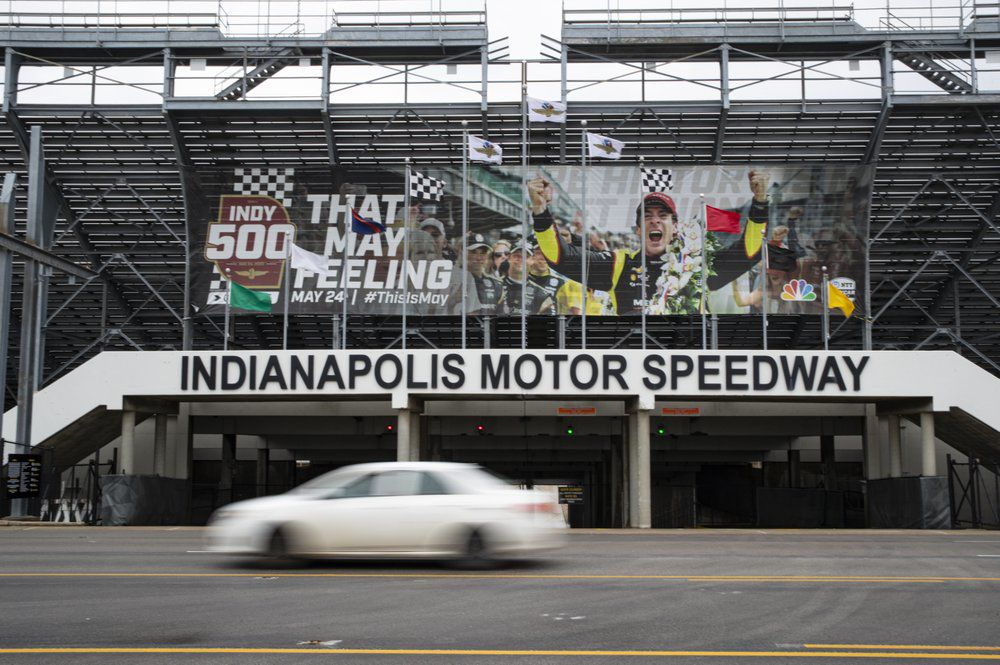A car drives past the entrance at the Indianapolis Motor Speedway in Indianapolis