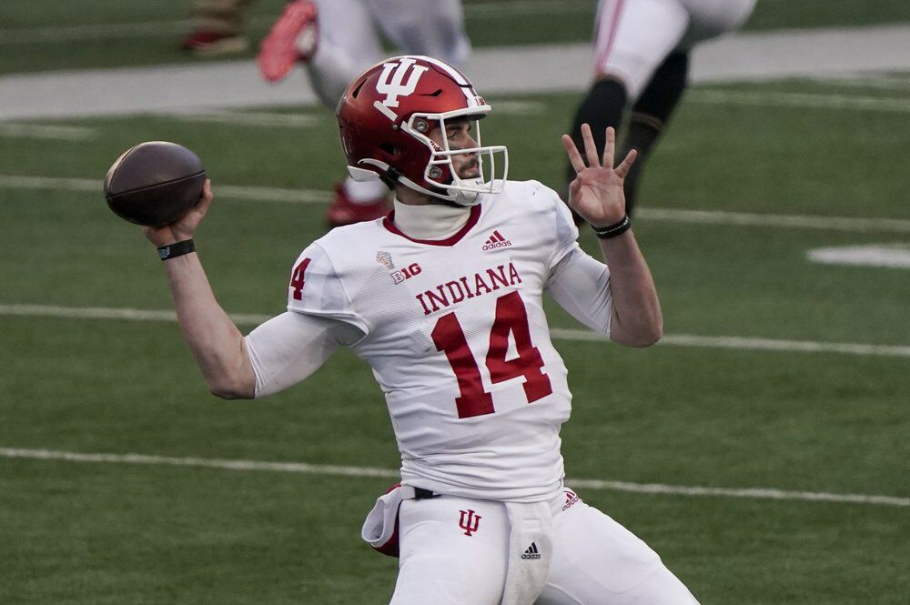 Indiana's Jack Tuttle throws a pass