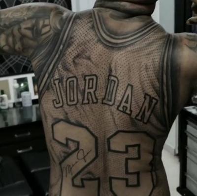 2dd64f9b793 Michael Jordan-obsessed fan gets 23 jersey tattoo across entire back ...