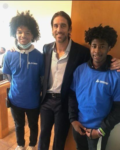 Green Bay's Aaron Rodgers poses with Fern Creek High School students at Kentucky Derby