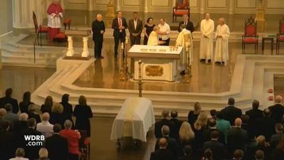 IMAGES: Faith, memories and smiles mark final farewell for John Asher