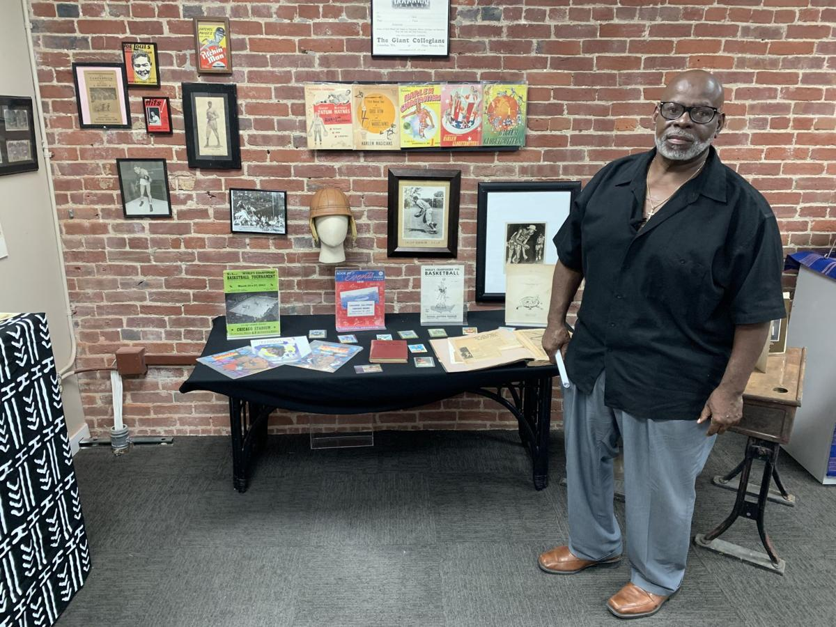 Lamont Collins shows off artifacts from Roots 101 African American History Museum