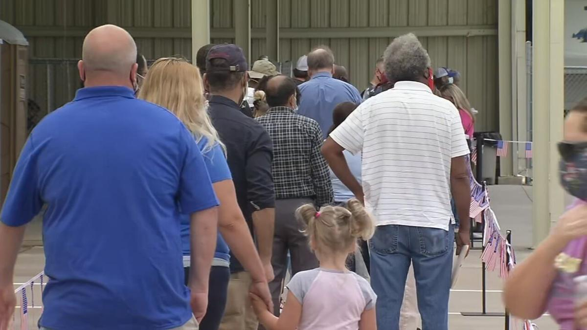 Line to receive in-person unemployment assistance in Louisville on Monday, Aug. 3, 2020