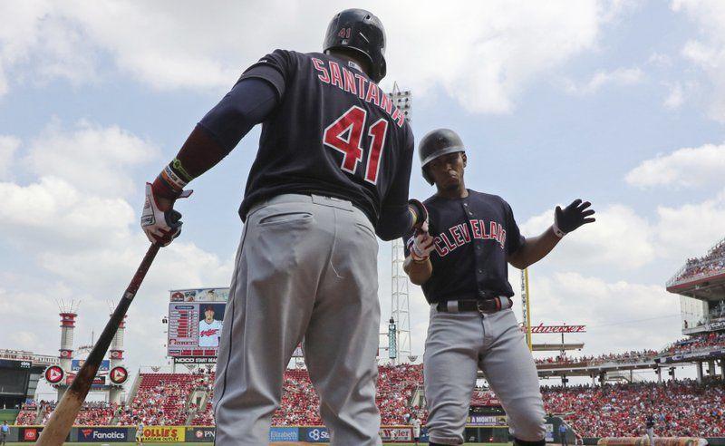 Francisco Lindor, right, is congratulated on a solo home run