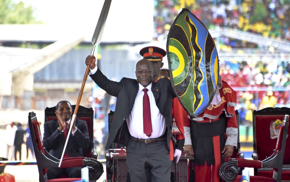 Tanzania President John Magufuli with ceremonial spear and shield