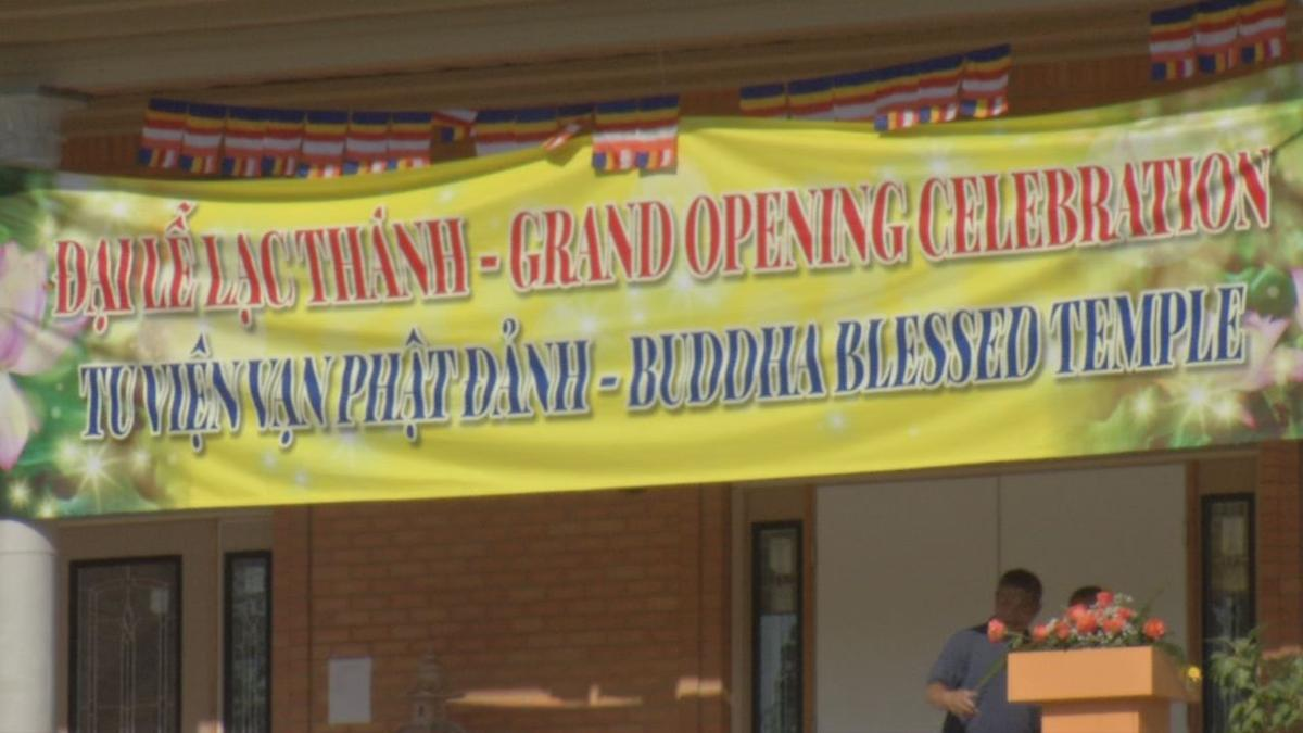 Sign at Buddhist temple opening