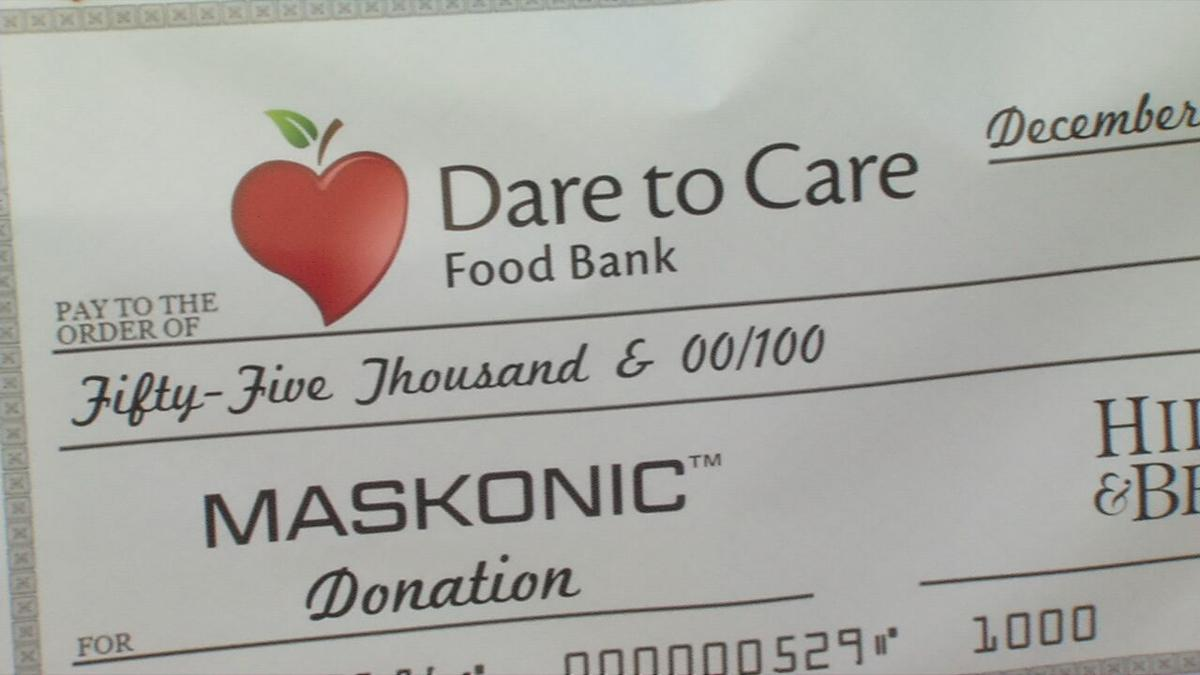 Dare to Care $55K check from Hillerich & Bradsby