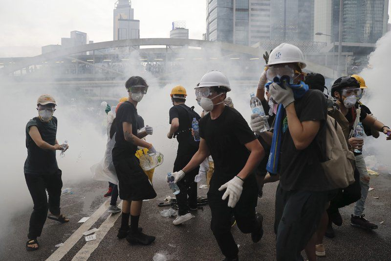 Hong Kong Protesters Tear Gas Via AP