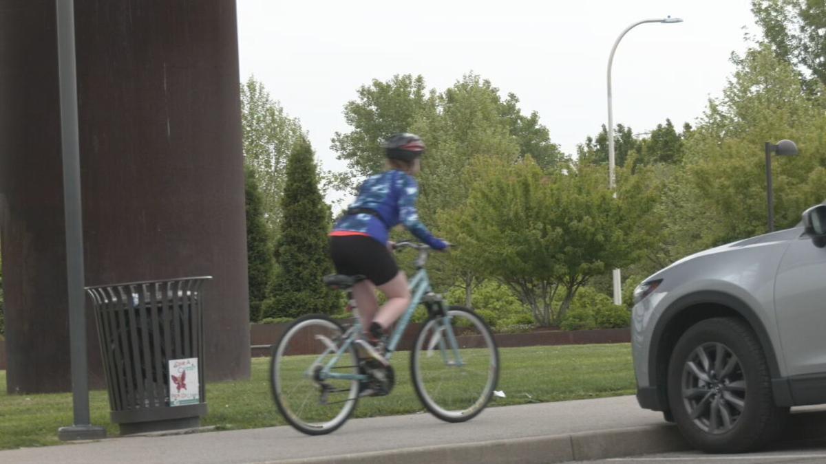Sianna Malone rides her bike under the Big Four Bridge