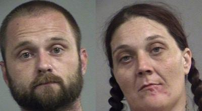 LMPD says suspects were found with drugs, cash and stolen guns