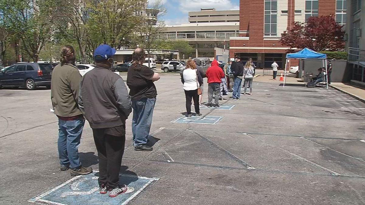 Kentuckians wait for in-person assistance with unemployment benefits outside Louisville's downtown office on April 15.