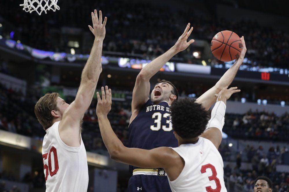 Notre Dame's John Mooney (33) shoots over Indiana's Joey Brunk