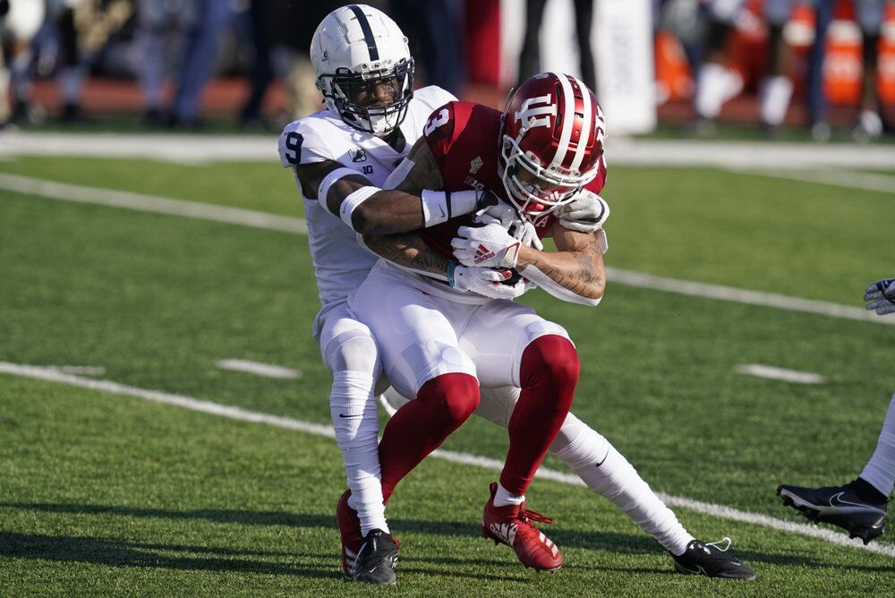 Indiana's Ty Fryfogle (3) is tackled by Penn State's Joey Porter Jr.