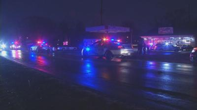 Louisville Metro Police respond to the scene of a double homicide
