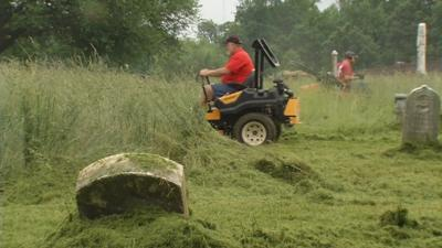 Volunteers clean up abandoned, overgrown Louisville cemetery in time for Memorial Day