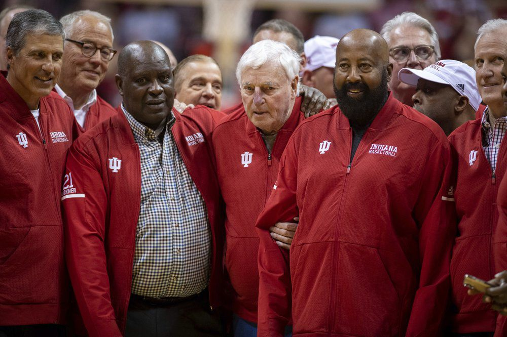 Bob Knight surrounded by former players and staff