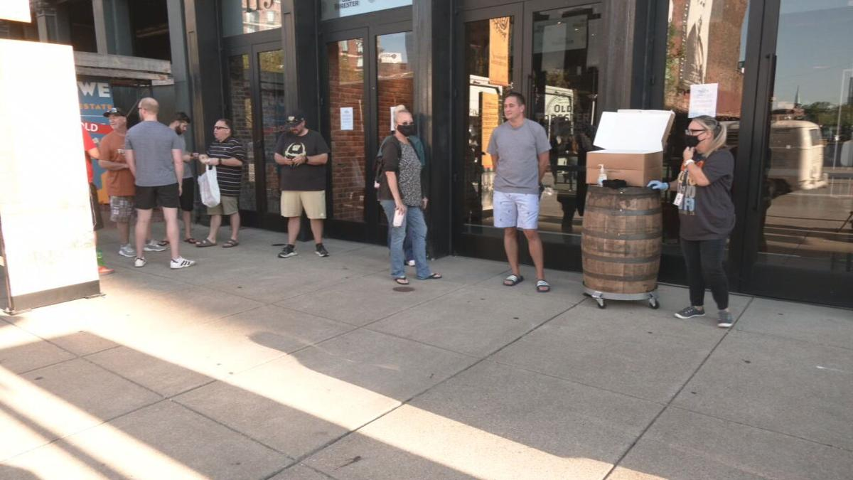 People wait in line at Old Forester Distillery in Louisville