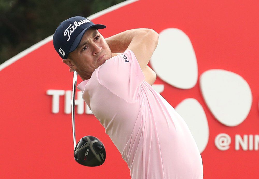 Justin Thomas of the United States watches his shot