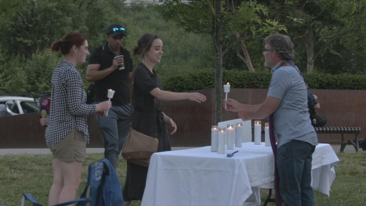 People receive candles for Prayer Vigil at Big Four Bridge.jpeg