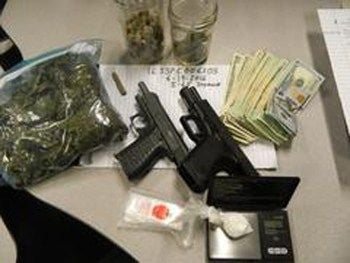 Police seize drugs, guns and cash during traffic stop near Seymour