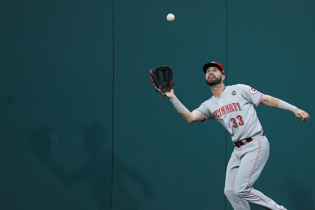 Jesse Winker catches a fly ball