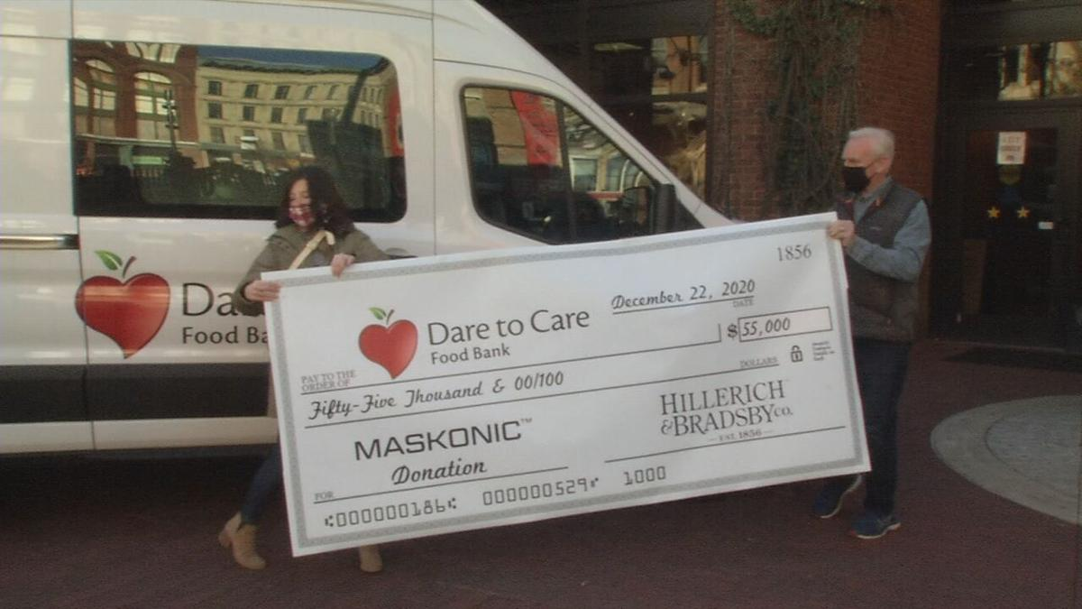Dare to Care Donation check from Hillerich & Bradsby