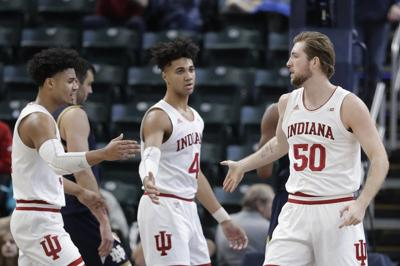 Indiana's Joey Brunk (50) is congratulated by Justin Smith (3) and Trayce Jackson-Davis