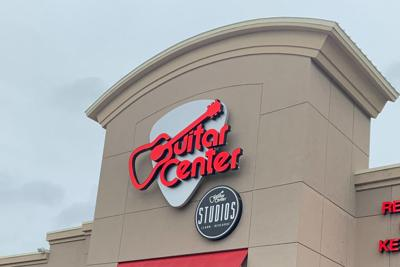 Guitar Center logo on store