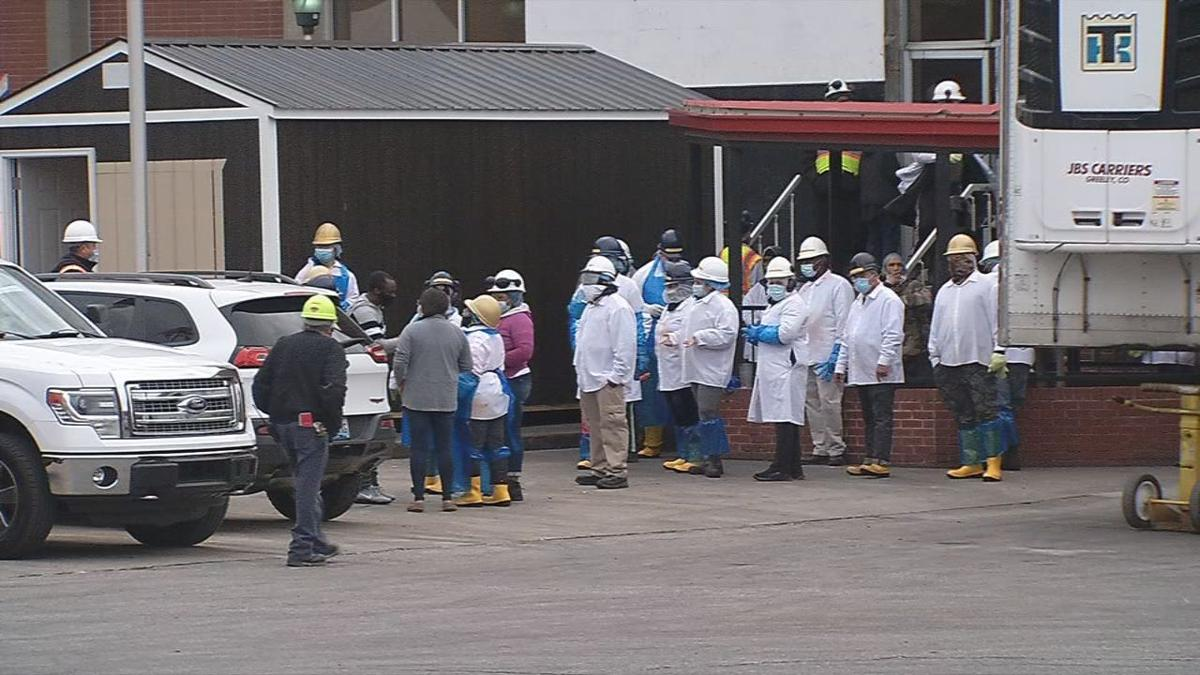 Workers outside the JBS plant on Story Avenue in Butchertown