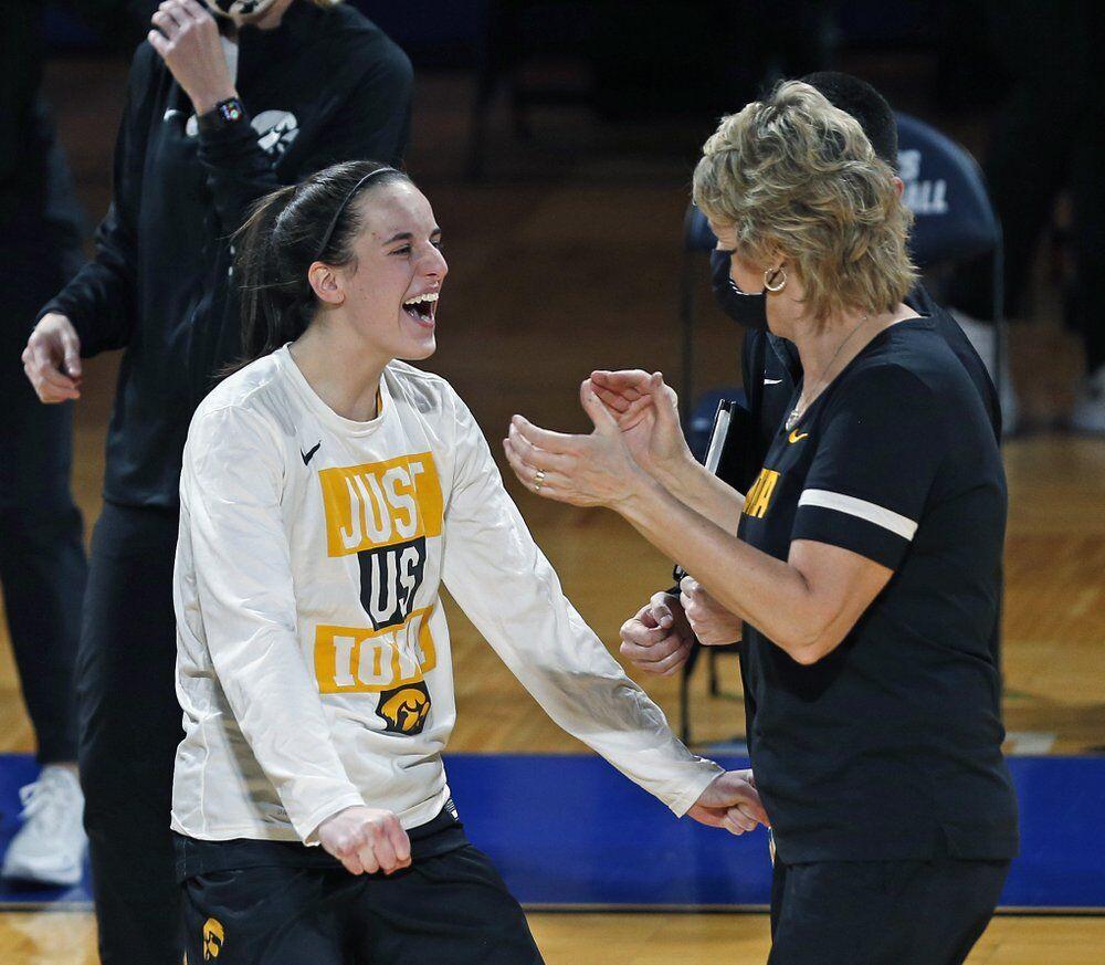 Iowa guard Caitlin Clark celebrates with coach Lisa Bluder