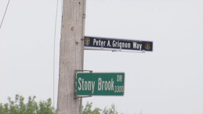 Corner of Stony Brook Drive and Six Mile Lane dedicated to fallen officer