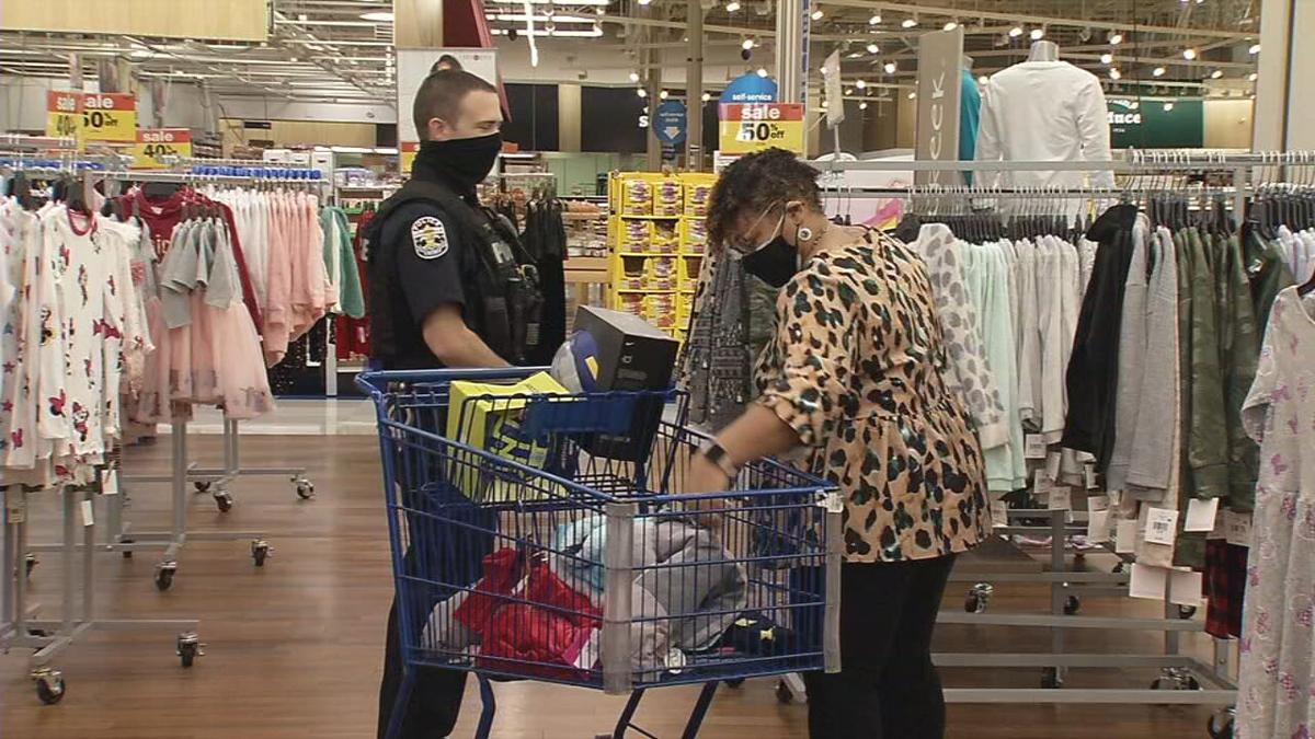 Shop with Cop 2020 - LMPD officer and teacher near cart