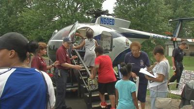 Students in Newburg neighborhood celebrate end of summer with back-to-school bash