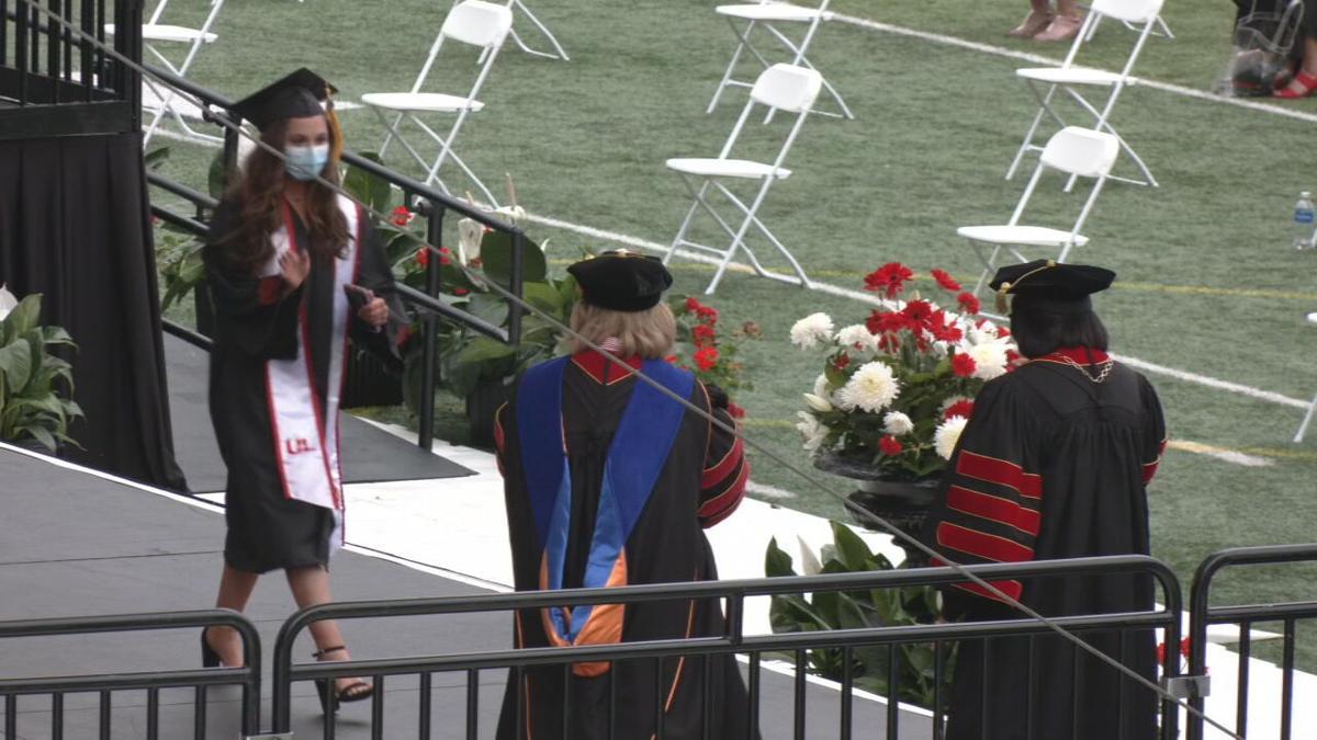 UofL diploma during graduation ceremony.jpeg