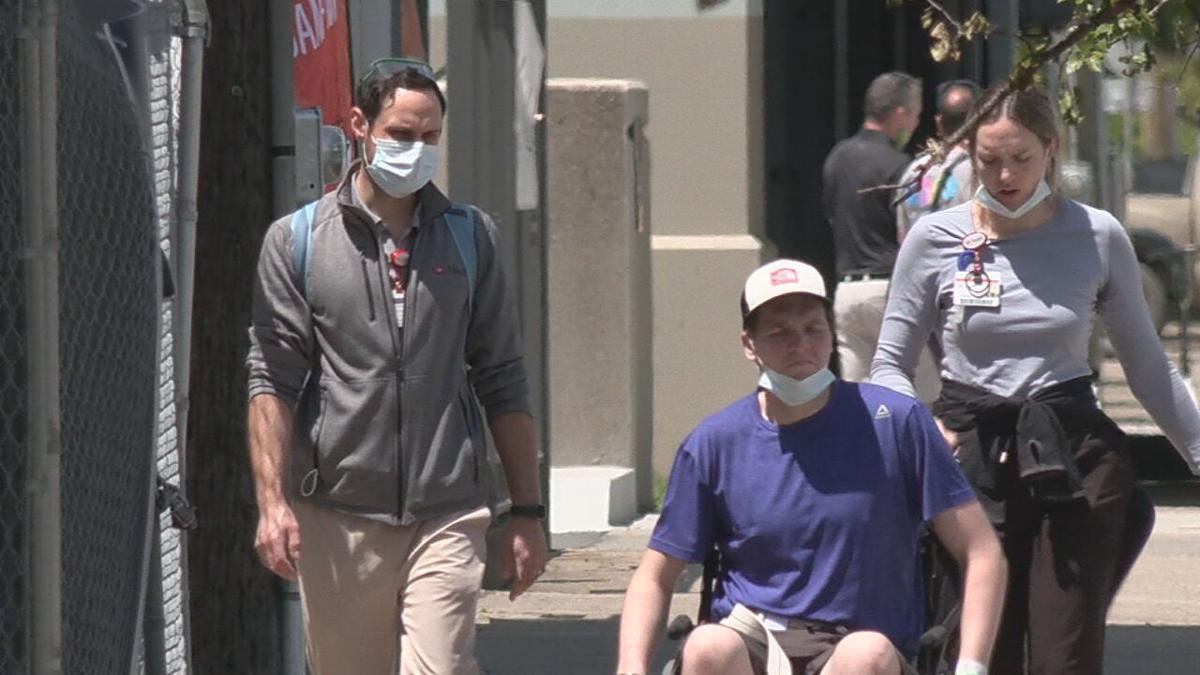 Group walks with masks in Louisville.jpeg