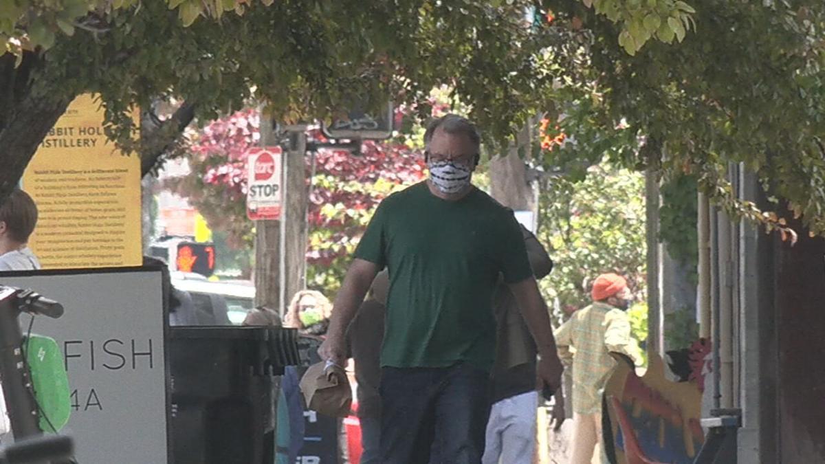Man walks with mask in Louisville.jpeg