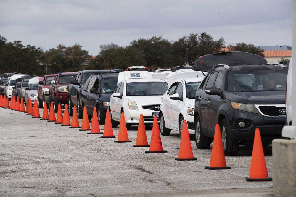 Hundreds of cars receive supplies at NRG Park AP.jpeg