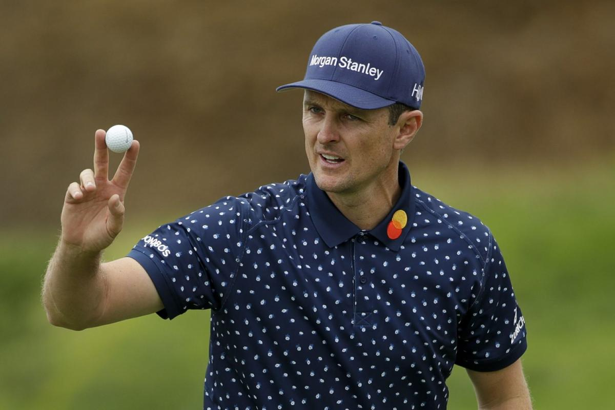 Justin Rose waves