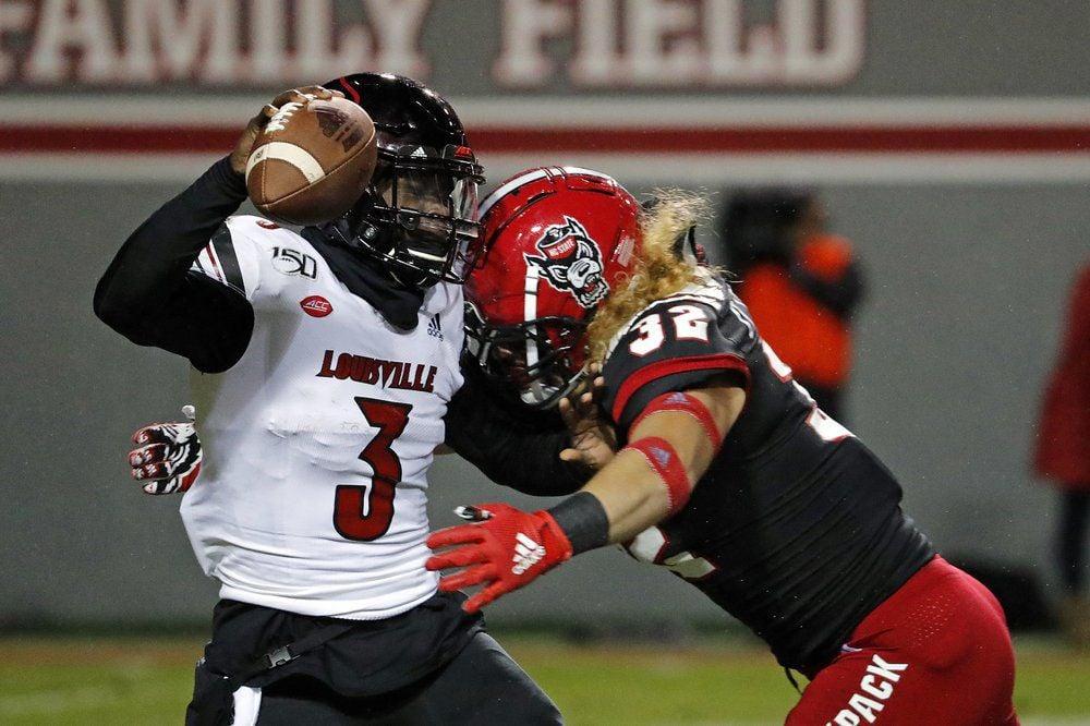 North Carolina State's Drake Thomas (32) sacks Louisville quarterback Micale Cunningham