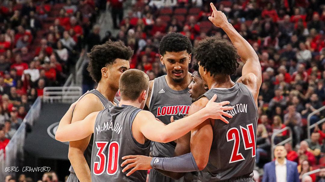 Louisville basketball huddle