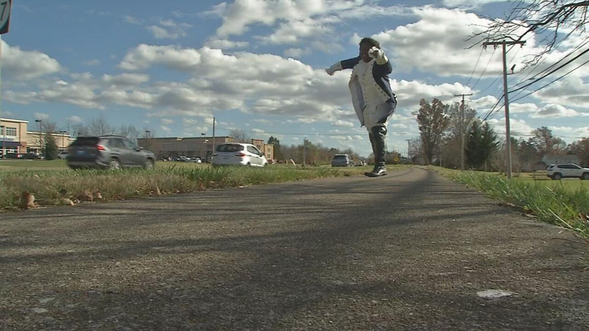 Performing 'Hamilton' hits, Male High School grad turns street into stage
